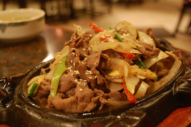 Bulgogi is a Korean dish that usually consists of grilled marinated beef. (image: Flickr/ stu_spivack)