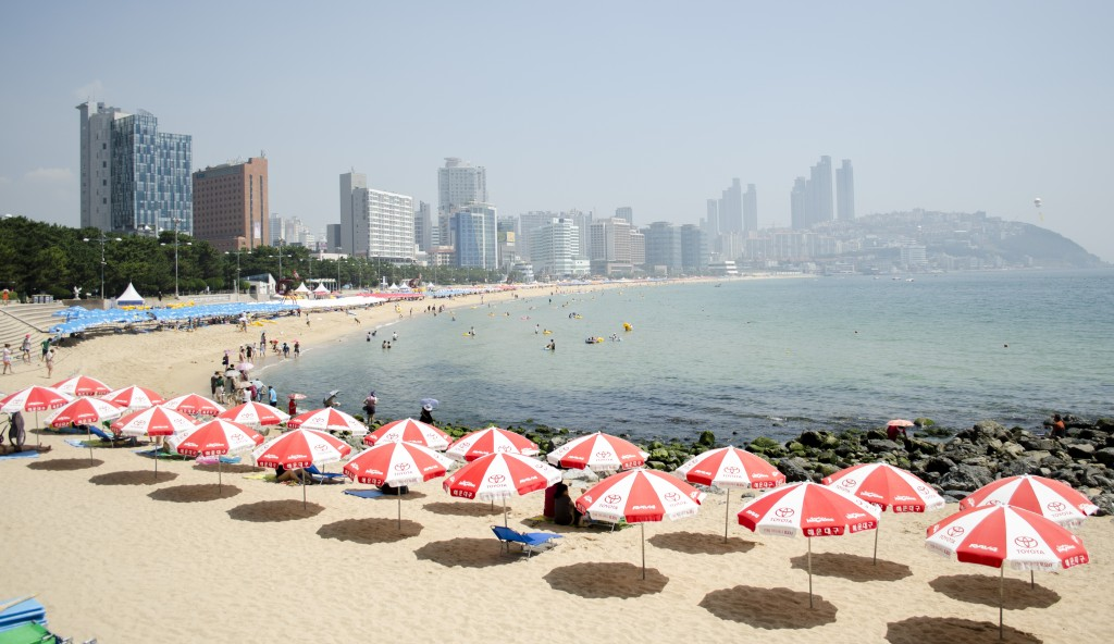 Busan's Haeundae district is best known for its beach that attracts millions of visitors each summer. (image: Wikimedia)