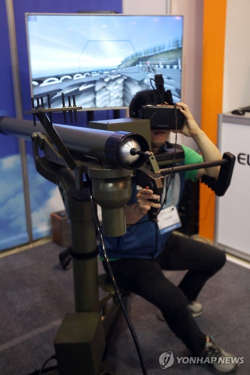 A visitor gets a virtual experience of firing a shoulder-launched surface-to-surface missile.