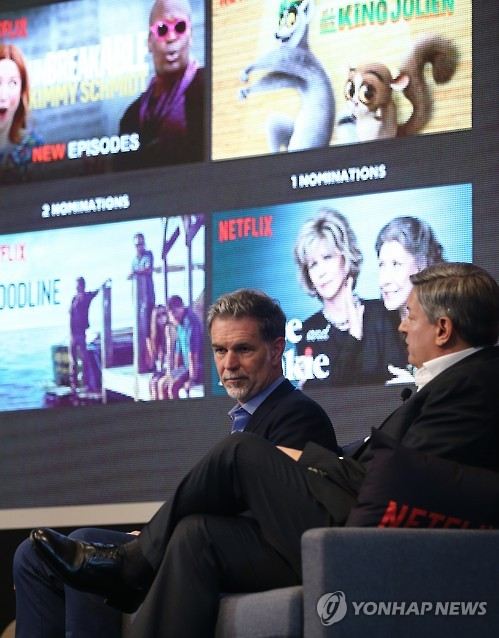 Reed Hastings (L), CEO of Netflix, and the company's chief content officer Ted Sarandos speak at a media event in Seoul on June 30. (image: Yonhap)