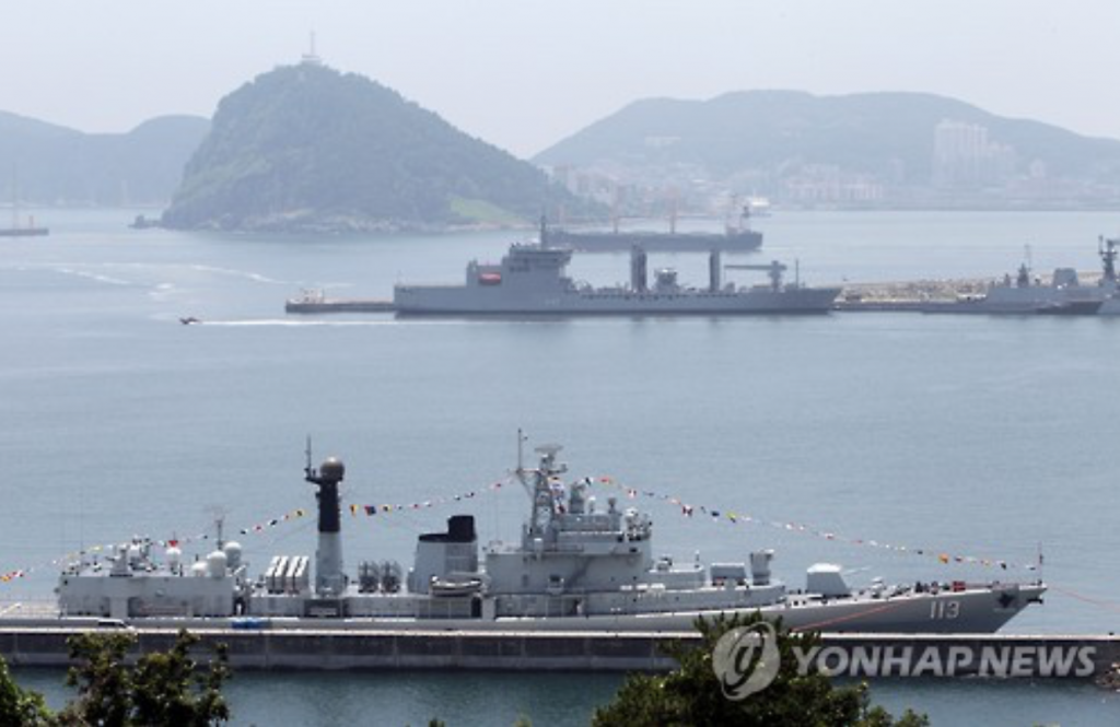 Visiting Chinese destroyer the Qingdao (front) and Indian naval tanker Shakti (back) dock at the dock of the Naval Operational Command in South Korea's southeastern city of Busan on June 23.