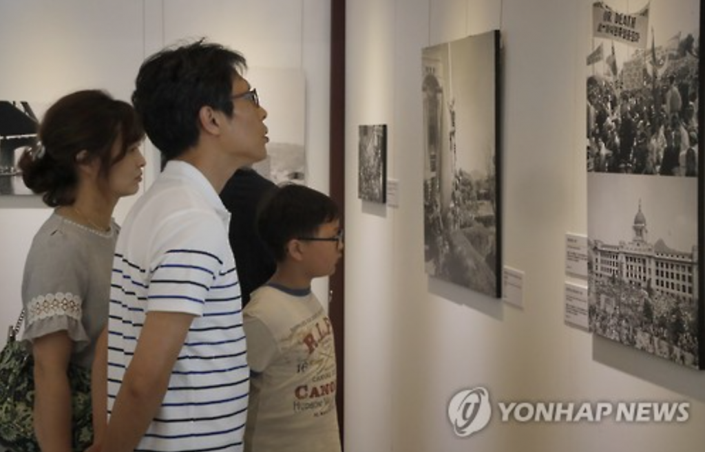 Visitors at the photo exhibit, titled 'The Korean War and Seoul viewed by the Associated Press(AP)'.