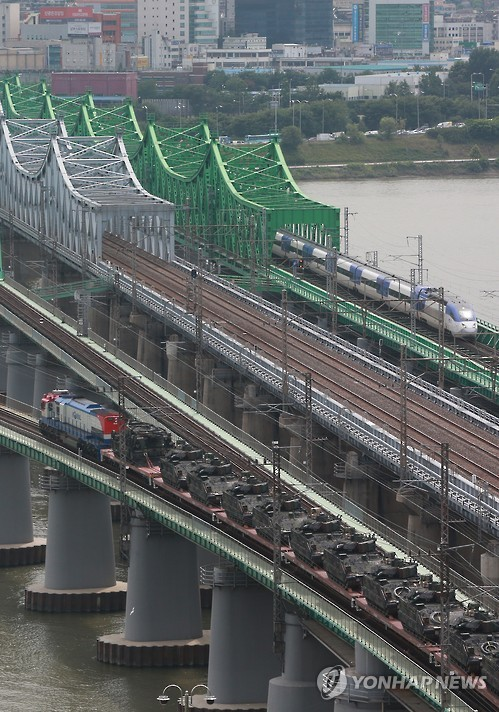 A freight train carrying armored vehicles crosses a bridge over the Han River. (image: Yonhap)