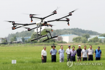 Farmers Turn to Drones for Crop-Spraying