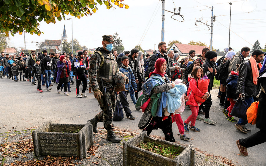 Syrian refugees and migrants pass through Slovenia, 23 October 2015. (image: Wikipedia)