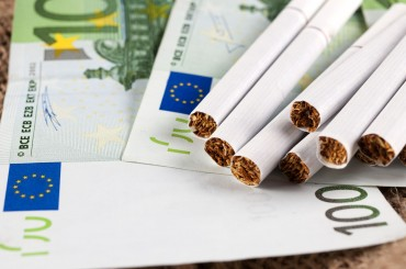 Cigarette Tax Related to Corruption and Happiness?