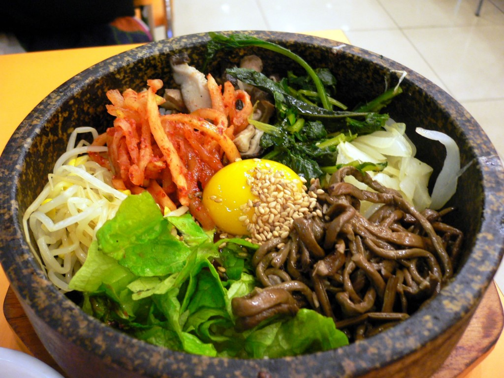 Bibimbap is an iconic Korean dish served as a bowl of warm white rice topped with sautéed and seasoned vegetables. (image: Wikimedia)