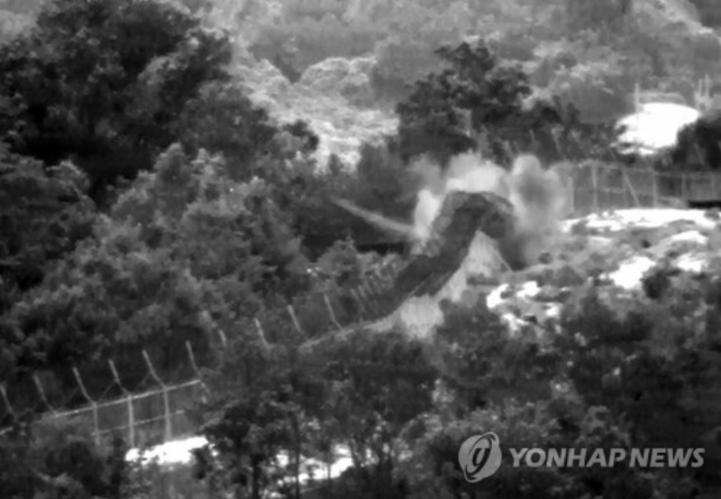 Released on Aug. 10, 2015, by the Joint Chiefs of Staff, the photo shows wooden-box mines, secretly buried by North Korean soldiers, being exploded around a gate on the southern side of the DMZ near the city of Paju, north of Seoul, on Aug. 4, 2015.