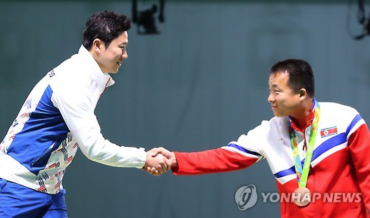 North and South Korean Medalists Exchange a Friendly Handshake at Rio 2016