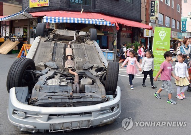 Overturned Vehicle Marks Coming Car Free Day