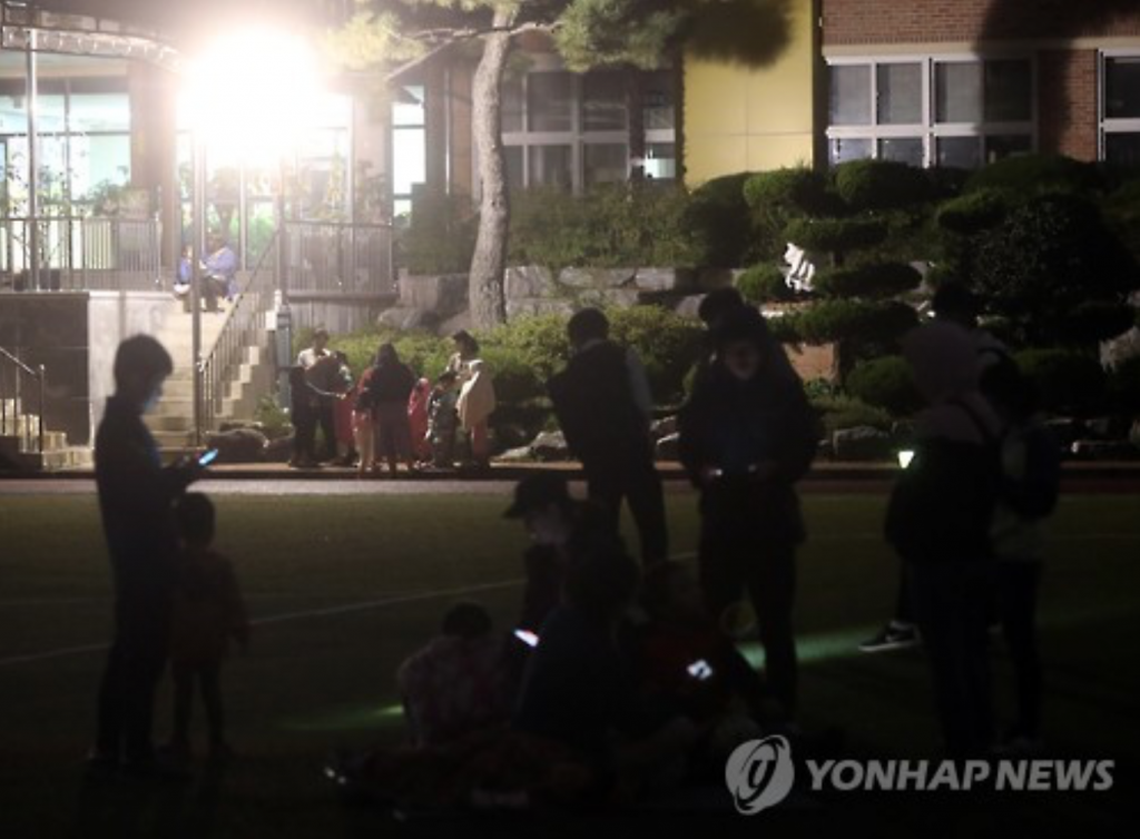 Residents in Ulsan evacuated to a local elementary school playground after Monday's aftershock, which was also felt in the city.