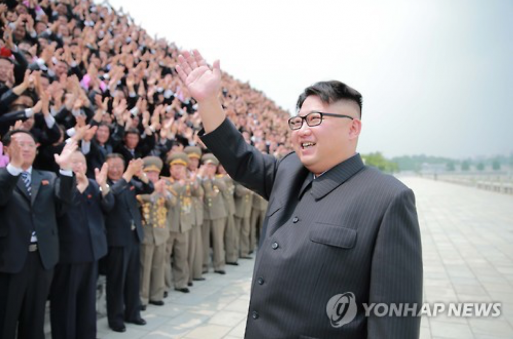 North Korean leader Kim Jong-un waves his right hand to attendants in a military event held in Pyongyang. (image: Yonhap)