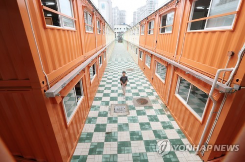 Elementary School Students Studying in Container Classrooms
