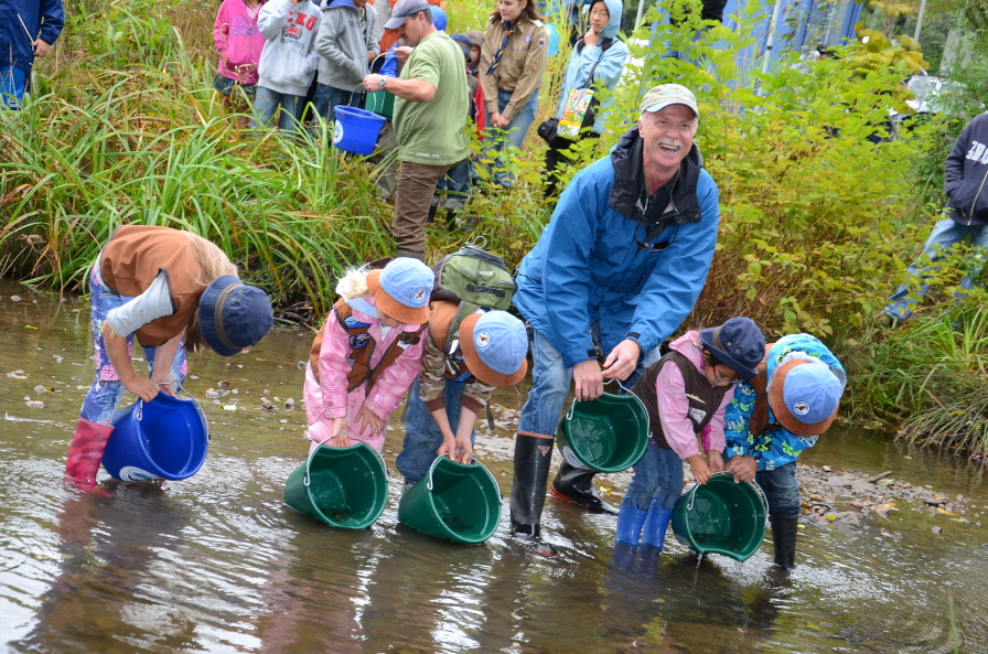 World Rivers Day founder and chair, Mark Angelo, along with local school children, release trout into an urban stream in Burnaby, British Columbia during last year's Wolrd Rivers Day celebrations. (image: World Rivers Day Committee)