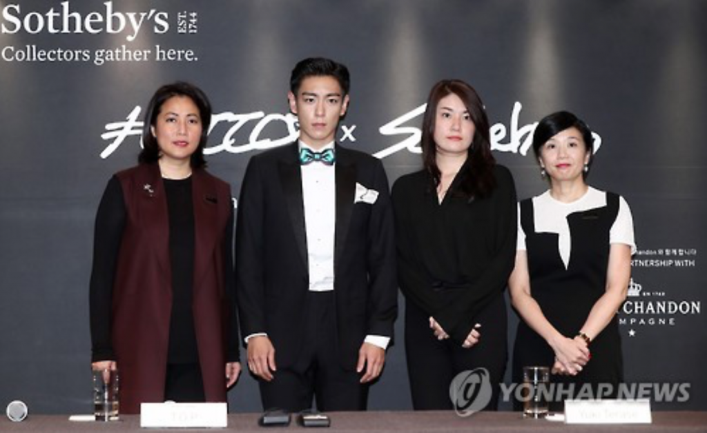From left: Patti Wong, chairperson of Sotheby's Asia; T.O.P, a member of South Korean boy band BigBang; Yuki Terase, a specialist in Sotheby's Contemporary Asian Art department; and Evelyn Lin, head of Sotheby's Contemporary Asian Art department. (image: Yonhap)