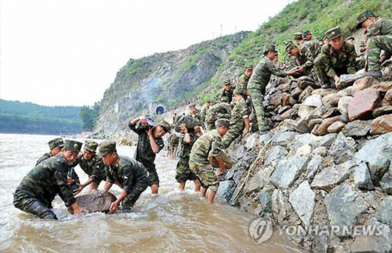 North Korean Students Killed Trying to Recover Portraits of Supreme Leaders from Flood