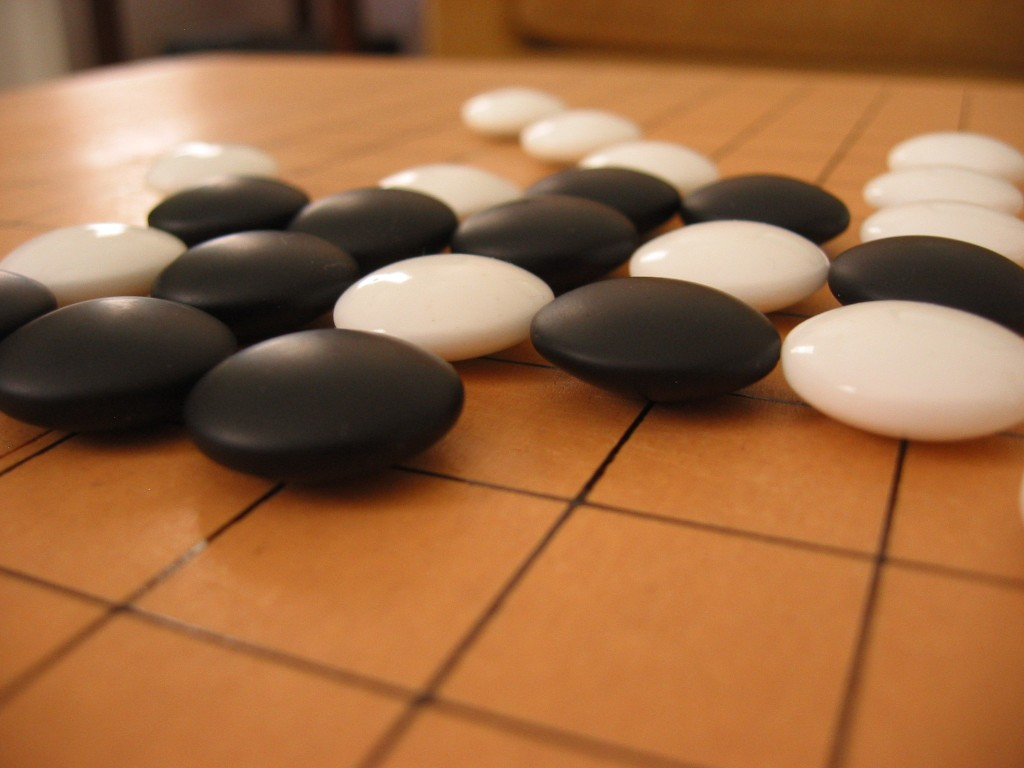 "Go, known as ""baduk"" in Korea, originated in China more than 2,500 years ago. It involves two players alternately placing black and white stones on a checkerboard-like grid of 19 lines by 19 lines. (image: Wikimedia)"