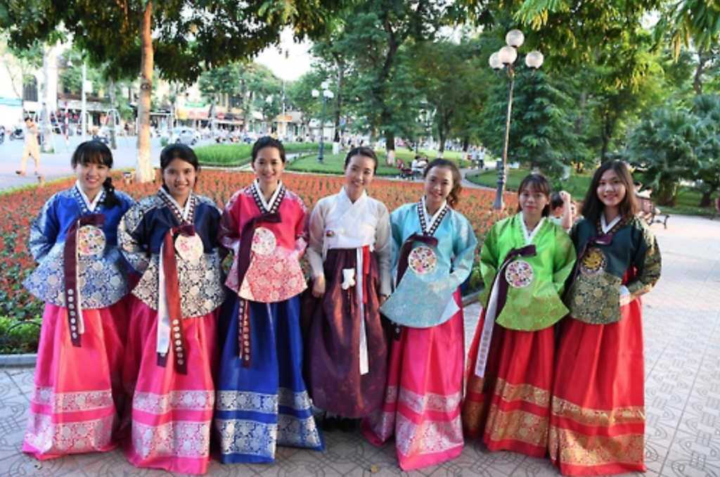 Photo provided by the Korean Cultural Center in Vietnam shows Kwon Miru (fourth from the left) in Korean traditional dress hanbok. (image: Yonhap)