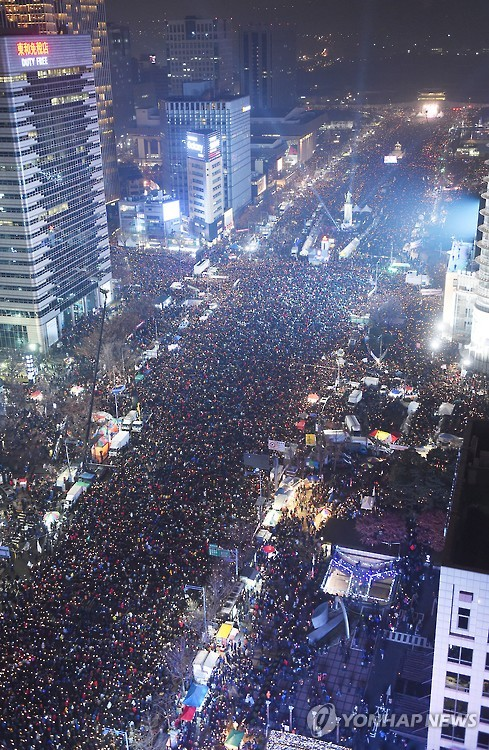 """At least a million lit up their candles for the country, but the police estimated the number at just 200,000,"" said the developer. ""It angered me, so I decided to create the app."" (image: Yonhap)"