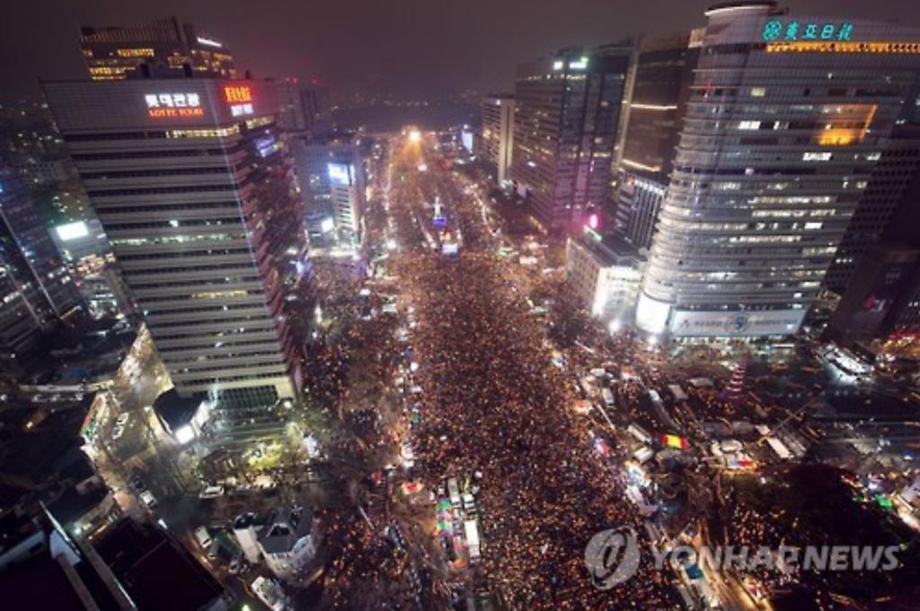 Hundreds of thousands took to the streets over the past five months demanding impeachment of President Park Geun-hye. (image: Yonhap)