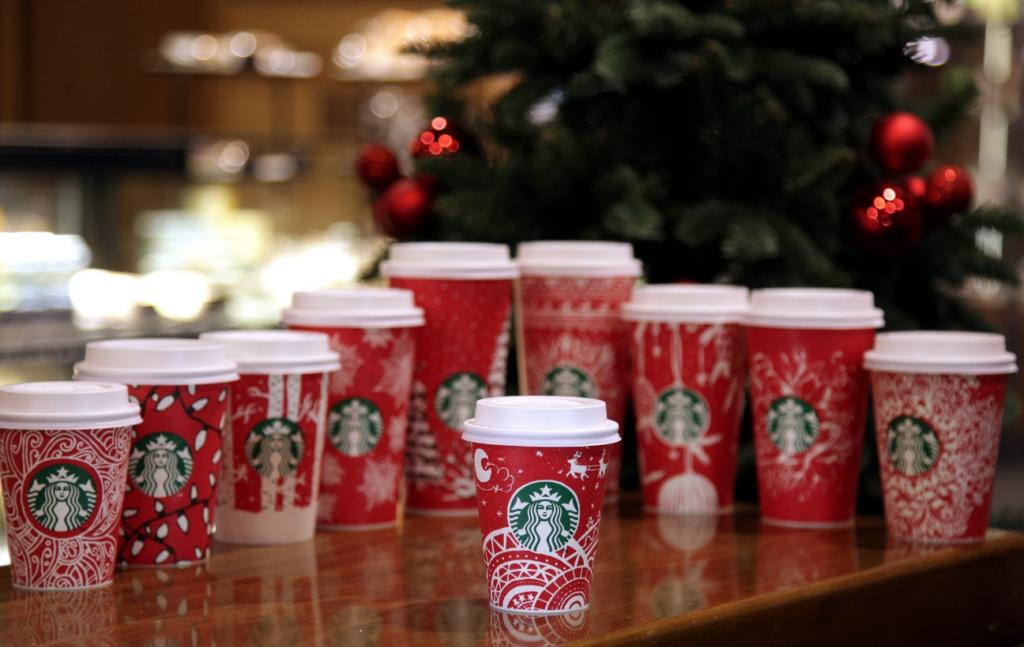 "Kwon's design is called ""Sleigh Ride"", and it's a 'short' sized cup with the main illustration including Santa's sleigh on a starry night. (image: Starbucks)"