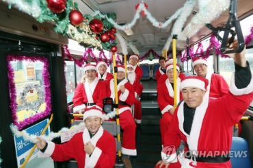 Public Bus Decorated with Mistletoe and Santa Claus Drivers