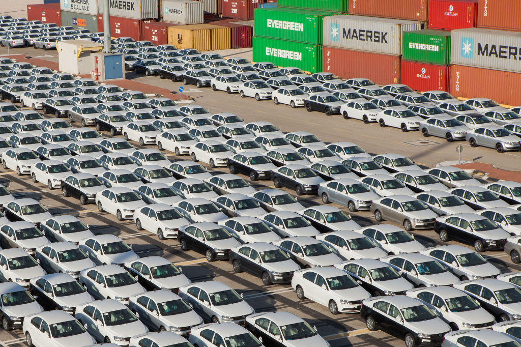 35831829 - rows of new cars parked in an international port