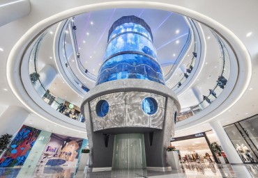 Shoppers at the Oceania Mall Take Elevator through World's Tallest Cylindrical Aquarium Designed and Built by International Concept Management