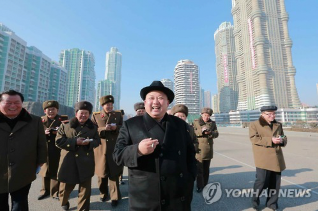 "Accompanied by officials, North Korean leader Kim Jong-un tours the construction site of a newly developed district in Pyongyang, named ""Ryomyong Street."" (image: Yonhap)"
