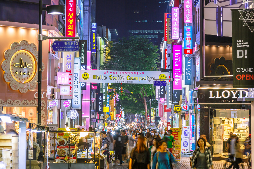 The South Korean government hopes to follow the cases of Japan and Taiwan which successfully overcame China's sanctions on the tourism industry a few years ago over territorial and diplomatic disputes. Crowds tourist at the Myeong-Dong street night market with neon lights shop signs. The location is the premiere district for shopping in Seoul city. (Image credit: Kobiz Media/Korea Bizwire)