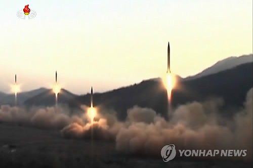 This photo, released by North Korea's Korean Central TV on March 7, 2017, shows four ballistic missiles being fired during a drill at the Hwasong artillery units of the North Korean Army's Strategic Force. North Korea on the previous day fired four ballistic missiles from an area near Tongchang-ri in northwest North Korea. They flew as far as 1,000 kilometers before landing within or very close to Japan's exclusive economic zone. (For Use Only in the Republic of Korea. No Redistribution) (Yonhap)