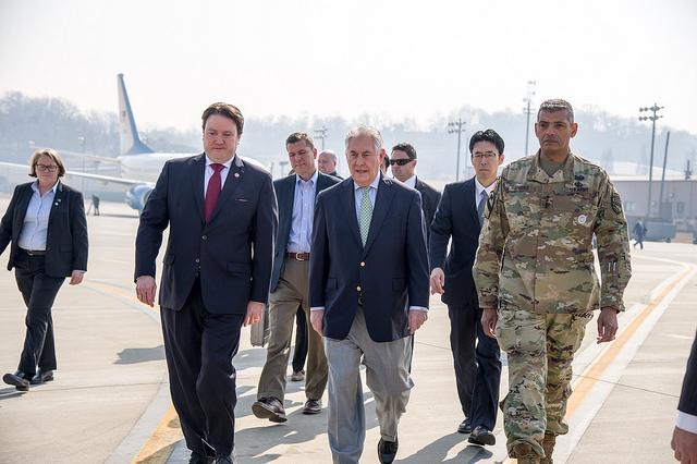 U.S. Secretary of State Rex Tillerson walks with Marc Knapper, U.S. Embassy Seoul Chargé d'Affaires ad interim, and Gen. Vincent K. Brooks, U.S. Forces Korea commander, upon arriving at Osan Air Base outside of Seoul, South Korea, on March 17, 2017. [Image: State Department photo/ Public Domain]