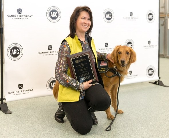 Denise Corliss, Bretagne's former handler, with current working partner, Taser (image: American Kennel Club)