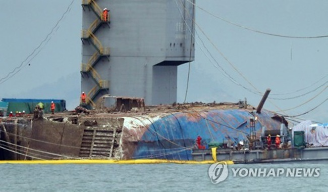 It will take about eight days to lift the ship and move it to the port, with an additional four days to move it onto a dry dock, the ministry added.' (Image: Yonhap)