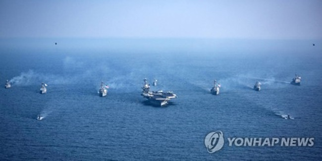 South Korean and U.S. warships, including the U.S. nuclear-powered aircraft carrier Carl Vinson (C), sail in waters off the South's east coast during joint drills against North Korean provocations on March 22, 2017. (Image: Yonhap)
