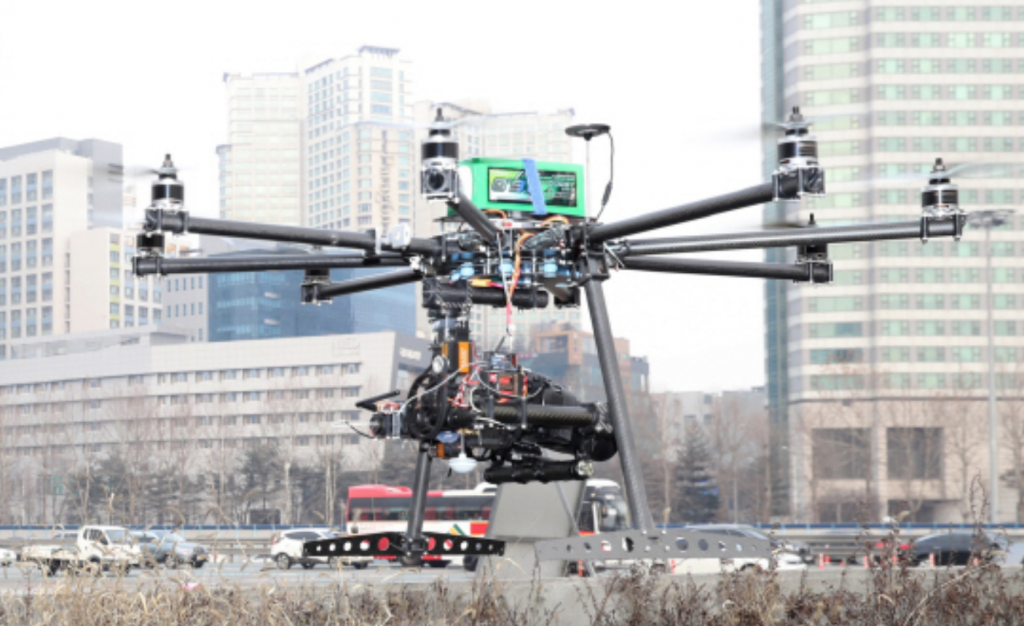Equipped with a 36.3-megapixel camera, the drones weigh around 5 kilograms each, and hover 25 to 30 meters above ground. (image: Yonhap)