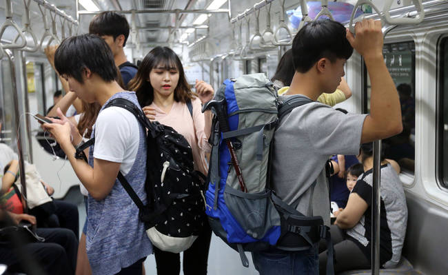 Busan Campaign Prompts Subway Riders to Wear Backpacks on Their Front