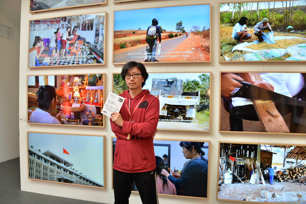 "Artist Lee Wan poses in front of ""The Frame"" TVs from Samsung Electronics that display his video work ""Made in"". (image: Samsung Electronics)"