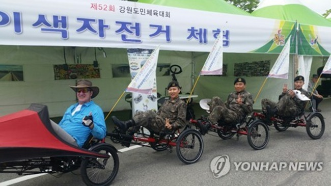 Cycle travel writer Kim Min-sook, who is also an honorary tourism ambassador for Gangwon Province where she was born, and her husband Eric Wehrheim from Germany have launched a recumbent bicycle rental service at Hoengseong Sports Complex in celebration of the 2018 Winter Olympics. (Image: Yonhap)