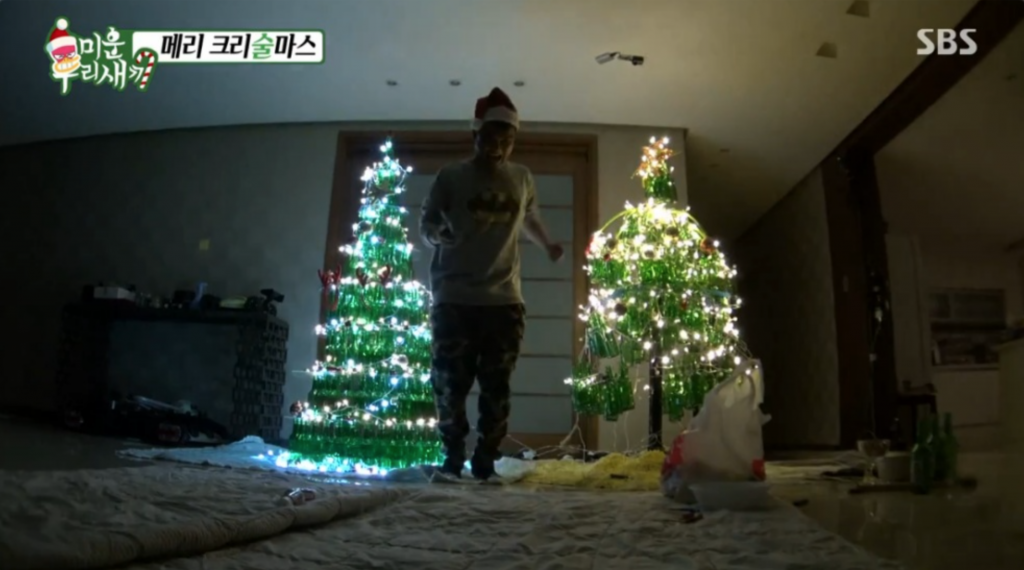 "Image captured from reality television show ""Mom's Diary - My Ugly Duckling"" shows singer Kim Gun-mo dancing in front of a Christmas tree made out of empty soju bottles."