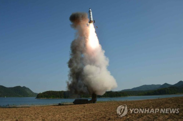 Photo released by the Rodong Sinmun on May 22 shows the test-firing of a new intermediate-range ballistic missile, known as the Pukguksong-2, in North Korea. (image: Yonhap)
