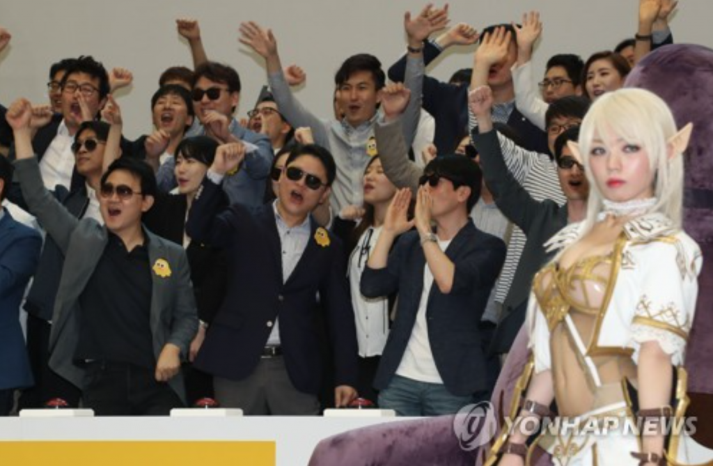 Employees of Netmarble Games Corp., South Korea's largest mobile games maker, perform at a ceremony to list the company's shares on the Korea Exchange. (image: Yonhap)