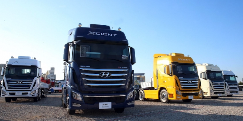 Hyundai's Xcient trucks displayed at a commercial car fair in Goyang. (image: Hyundai)