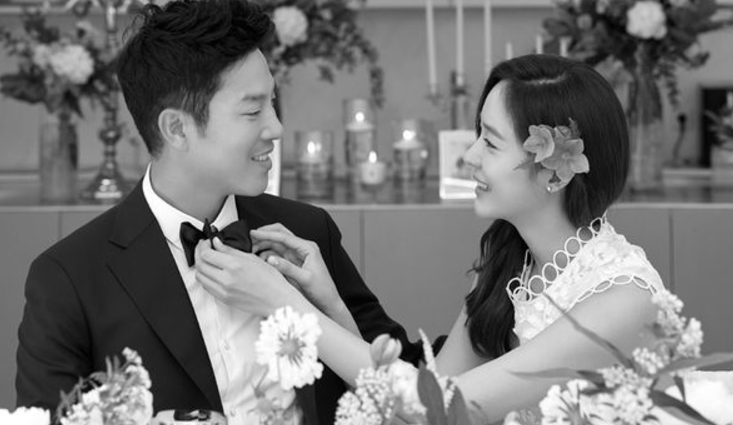 Actress and singer Sung Yu-ri with her husband Ahn Sung-hyun. (image: SL ENT)