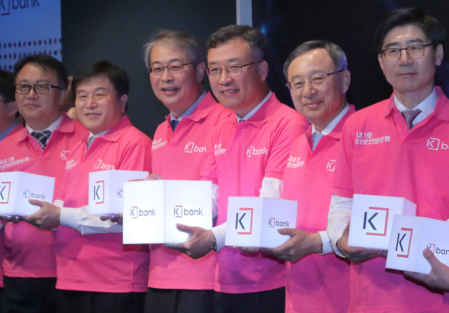 The rapid growth of K Bank is making its rivals nervous, with some bank heads praising the success of Korea's first internet-only bank as 'beyond expectations', and noting that they hope to maintain a good relationship as partners as well as contenders. (Image: Yonhap)