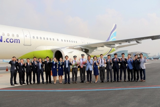 In this photo taken on June 1, 2017, and provided by Air Busan, Air Busan executives and employees stand before the company's 20th leased aircraft at Gimhae International Airport. (Image: Yonhap)