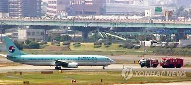 This captured image from Japan's largest broadcaster NHK shows fire trucks and Korean Air Line's B737-900 jet at Fukuoka airport after smoke was detected in the cockpit five minutes before landing on June 9, 2017. (Image: Yonhap)