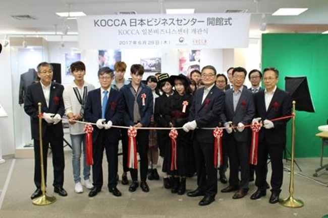 South Korean government officials and other attendees pose for a photo during an opening event of the business center helping Korean content companies enter the Japanese market on June 29, 2017, in Tokyo, Japan. (Image: Yonhap)