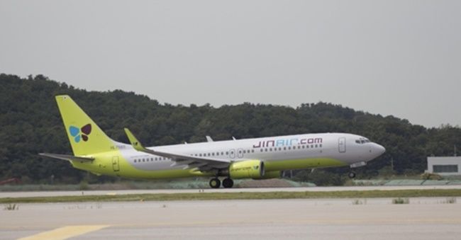 It currently operates three flights between the resort island and three domestic destinations -- Gimpo near Seoul, the southern port city of A Jin Air B737-800 passenger jet takes off from a runway in this undated photo. (Image: Jin Air)