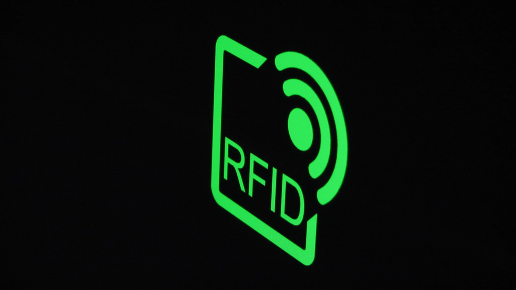 The RFID tags, which are affixed to trash cans commonly located at apartment complexes, calculate waste disposal fees then and there after measuring the volume of waste to be discarded.  (Image courtesy of Christiaan Colen RFID logo/flickr)